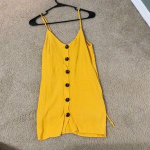 Yellow dress with buttons down middle.